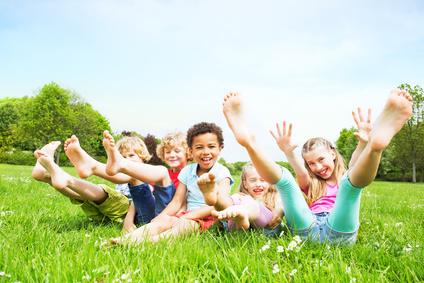 smiling kids on green grass